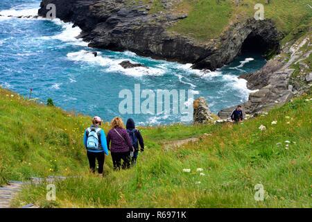 Tourists walking on Tintagel castle, Island Peninsula,Cornwall,England,UK - Stock Image