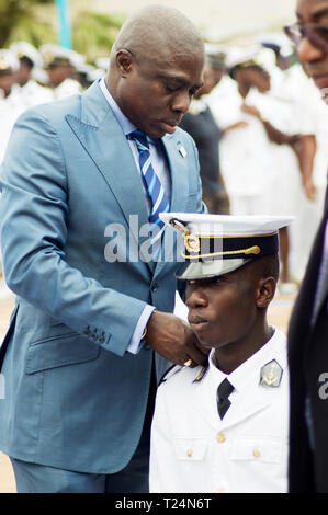 Abidjan, Cote d'Ivoire - August 3, 2017: ceremony of the shoulder of the students at the end of the cycle. The godfather putting the shoulders of a st - Stock Image