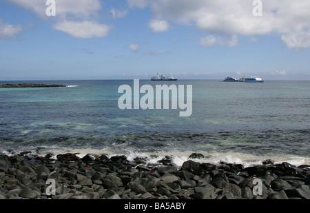 Tourist Boats Moored Off the Shore of Espanola Island, Galapagos Islands, Ecuador, South America - Stock Image