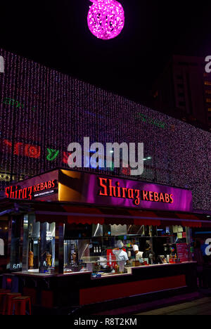 Shiraz Kebabs fast food outlet with chefs and Christmas lights, Orchard Road, Singapore - Stock Image