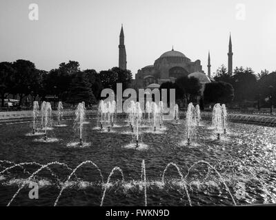 Black and white image of view over fountain in Sultanahmet Park to the landmark Hagia Sofia in Istanbul, Turkey - Stock Image