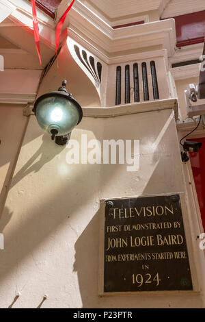 Television first demonstrated by John Logie Baird in 1924 plaque in Queens Arcade in Hastings, East Sussex, England , UK - Stock Image