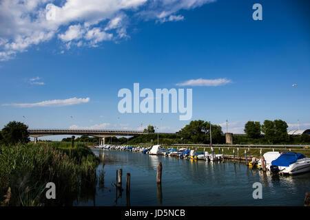 Sailboats and boats moored at the dock in Caorle - Italy in a beautiful sunny day - Stock Image