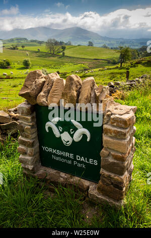 UK, Cumbria, Sedbergh, Owshaw, Yorkshire Dales National Park sign beside A684 road with Howgill fells in distance - Stock Image