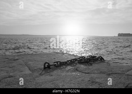 view of the sea from pier at sunset - Stock Image