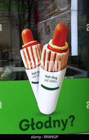 Hot Dog advertisment on a cafe window in Poland - Stock Image