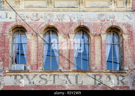Faded writing on the brick exterior of a building, Virginia City, Nevada, USA - Stock Image