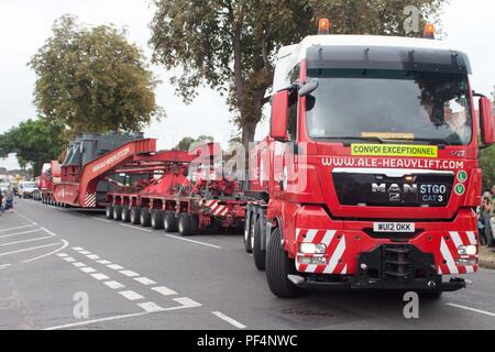 Surrey, UK. 19 August 2018.  68m long lorry carrying a electrical transformer navigates the narrow streets of Surrey. Credit: Andrew Spiers/Alamy Live News - Stock Image