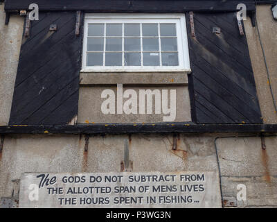 The gods do not subtract from the allotted span of mens lives the hours spent fishing: Notice on the wall at the Lyme Regis Marine Aquarium, Dorset - Stock Image
