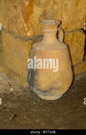 A reproduction fired clay water pot in living history museum of Nazareth Village in Israel. Similar to the type of water pot that would have been used - Stock Image