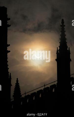 The partical solar eclipse between the central tower and roof turrets of York Minster, taken from Dean's Park. - Stock Image