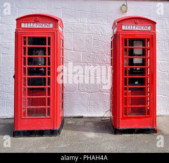 Two British traditional red telephone boxes at Lands end,Cornwall,England,UK - Stock Image