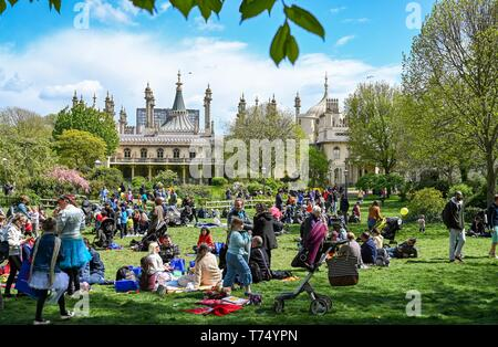 Brighton UK 4th May 2019 - Visitors enjoy the sunny but cool weather in Brighton Pavilion Gardens today with unsettled conditions forecast for the UK over the next few days. Credit: Simon Dack / Alamy Live News - Stock Image