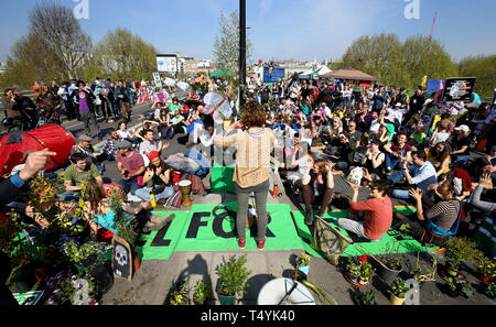 Extinction Rebellion demonstrators hold a community meeting on Waterloo Bridge in London. - Stock Image