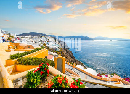 A picturesque scenic view of the Santorini caldera and the Aegean Sea from a resort terrace in the hillside village of Oia, Greece. - Stock Image