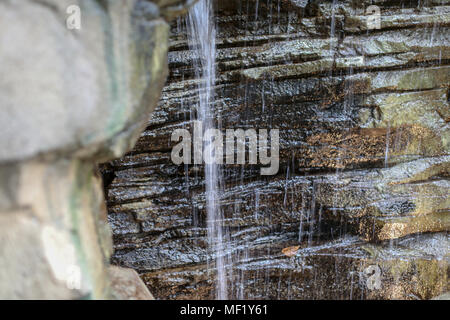 Still life images of small man made waterfall on display at Phipps Conservatory - Stock Image