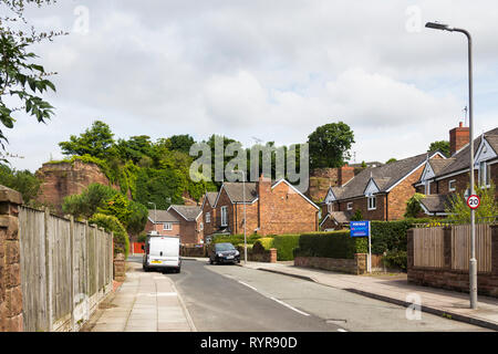 The Old Quarry, a road in Woolton, Liverpool with houses nestling in a disused red sandstone quarry, this being the south quarry of two adjacent worki - Stock Image