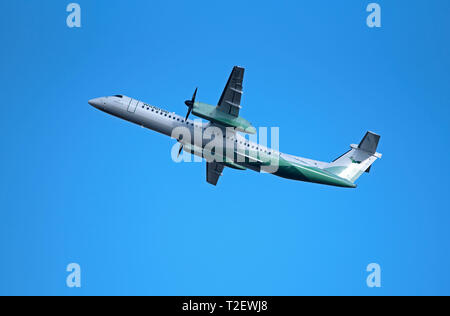 Aberdeen to Stavanger Norway flight departing Dyce airport for it's flight across the North sea. - Stock Image