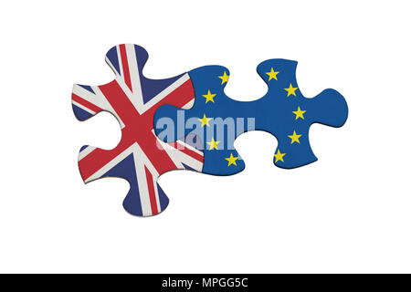 Jigsaw pieces representing the relationship between United Kingdom and European Union isolated on white background - Stock Image