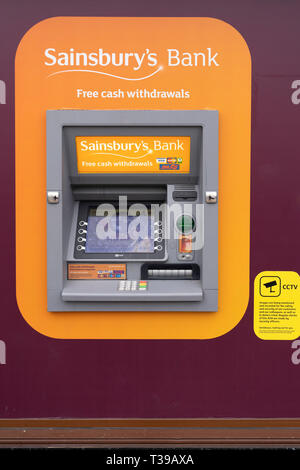 A Sainsbury's Bank cash machine on the front of a Sainsbury's supermarket in Stratford upon Avon - Stock Image