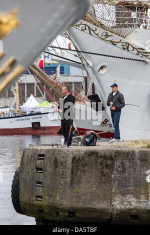 Aarhus, Denmark. 4th July, 2013. Two local anglers continue fishing unaffected by The Tall Ships Races 2013 in Aarhus, - Stock Image