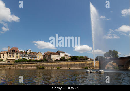 View of Bergerac town from the Dordogne river, with the old bridge, fountain and buildings, Bergerac, Dordogne France Europe - Stock Image