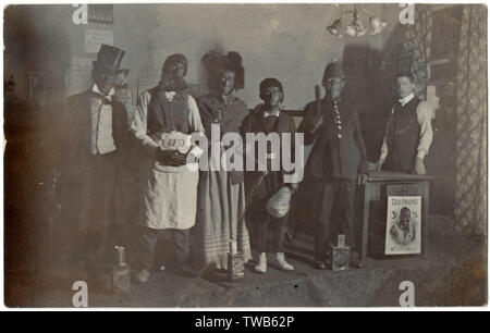 Silver Street Boys' School advanced class fancy dress group, most of them with blacked-up faces and hands. Their names are: Harold Blanchard, Philip Wilson, Arthur Thorne, Ernest Trafford, Billy Rigby and Billy Wand.      Date: 1909 - Stock Image