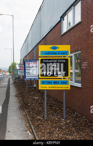 Signs placed by Brindle Properties advertising Industrial units and offices to let at Gladstone Court, Farnworth, - Stock Image