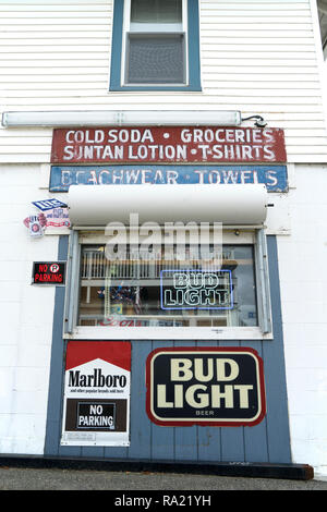 Small convenience store selling beach items, beer and cigarettes  in Old Orchard Beach, Maine, USA. - Stock Image