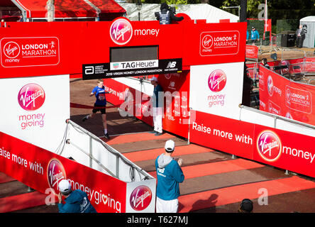 London, UK. 28th April 2019,Children cross the Finish Line of The London Marathon in The Mall.Credit Keith Larby/Alamy Live News - Stock Image