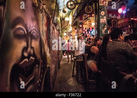 A backstreet bar with graffiti in Bangkok, Thailand. - Stock Image