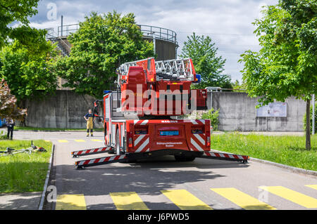 Rear view of an Iveco Magirus 160E30 turntable ladder truck of a Swiss fire brigade. Outriggers/jacks extended, - Stock Image