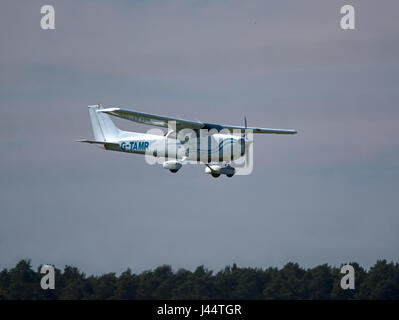 Cessna 172 Skyhawk coming in to land at Inverness Airport. - Stock Image
