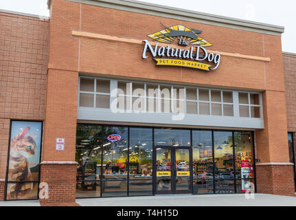 HICKORY, NC, USA-4/13/19:  The Natural Dog is a US store promoting holistic health and wellness for dogs and cats. - Stock Image