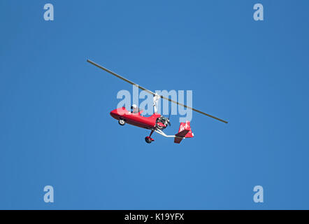 Motorsport MTO AutoGyro lifting off from the airfield at inverness Dalcross Airport in the Scottish Highlands. - Stock Image