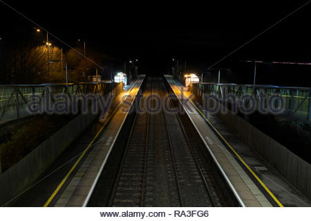 A deserted Cam & Dursley railway station at night, in Gloucestershire, UK. - Stock Image