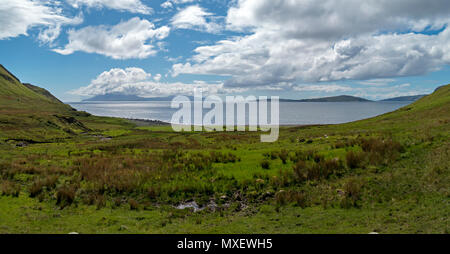 Glen Scaladal and Scaladal Bay on the Isle of Skye, with the Scottish Islands of Rum (left) and Soay (right) in the distance. - Stock Image