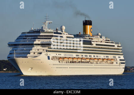 Costa Favolosa leaving Kiel in splendid evening sun - Stock Image