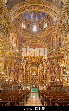 GRANADA, SPAIN - MAY 29, 2015: The nave of  baroque Basilica San Juan de Dios with the frescoes by Diego Sanchez - Stock Image