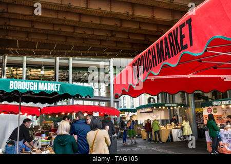 Borough Market individual stallholders pitches branded with red & green parasols with lit display bulbs inside at the traditional Southwark Borough Market Southwark London UK - Stock Image