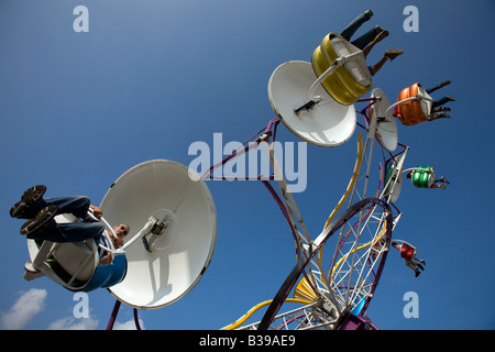 Carnival goers take a spin on the Paratrooper ride during Frisco Fest in Rogers, Arkansas, U.S.A. - Stock Image