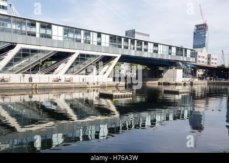 View of South Quay Station from Millwall Inner Dock in East London. - Stock Image