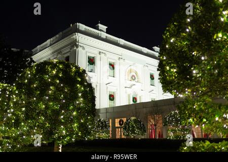 The west wing of the White House decorated for Christmas and lighted at night December 12, 2018 in Washington, DC. - Stock Image
