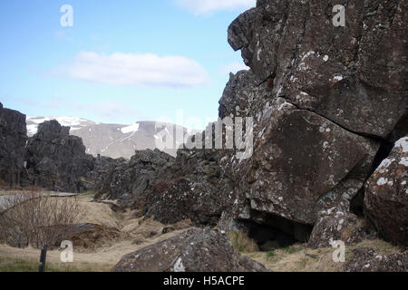Large rock near wooden walkway - Stock Image