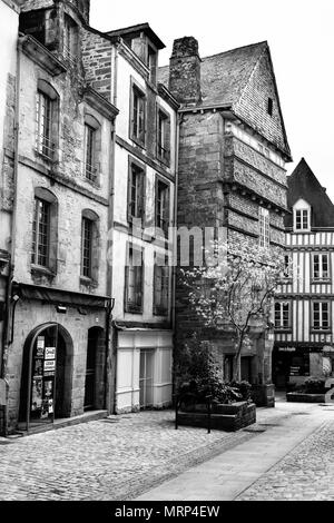 Half-timbered and stone buildings in the old medieval city of Quimper, Brittany, France. Black & white. B&W - Stock Image