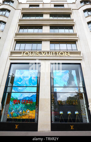 PARIS, FRANCE - JULY 22, 2017: Louis Vuitton fashion luxury store windows in Champs Elysees in Paris, France. - Stock Image