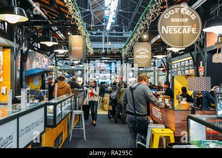 Lisbon, Portugal - Dec 30, 2018: Tourists Having Lunch At Lisbon Market Restaurant Of Mercado de Campo de Ourique In Lisbon - Stock Image