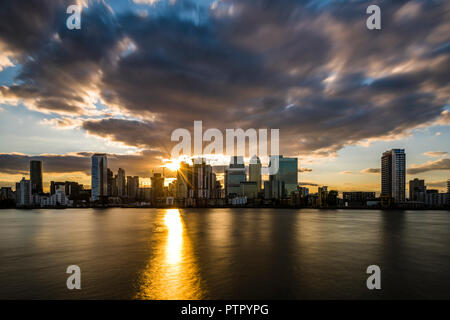 Sunset over the River Thames and Canary Wharf, London Docklands, London, UK - Stock Image