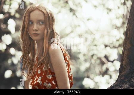 Beautiful tween girl in park - Stock Image