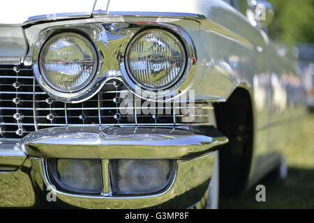 Westbury, New York, USA. June 12, 2016.  Chrome double headlights and running lights are seen in close up of classic1960 - Stock Image
